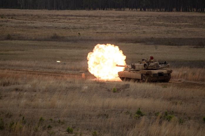 An M1A1 Abrams tank with 2nd Tank Battalion, 2nd Marine Division engages a target during semi-annual qualifications as part of a deployment for training exercise at Fort Stewart, Ga., Feb. 13, 2018. The DFT provides the opportunity to overcome home station range limitations as well as exercise the battalion's capability to deploy equipment and personnel.