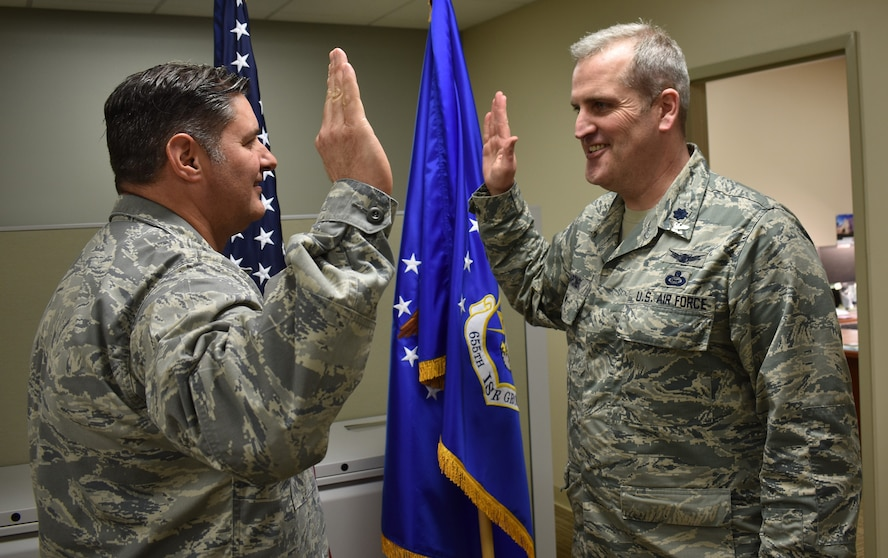 655th Intelligence, Surveillance and Reconnaissance Group Commander Col. J.D. McKaye (left) administers the Oath of Office to newly promoted colonel, Col. Joseph T. Marcinek, 655th ISRG deputy commander, during the February 24, 2018 unit training assembly here
