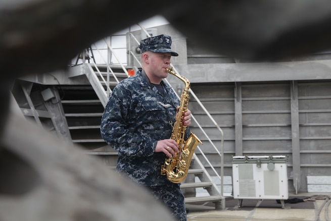 A Navy musician plays the saxophone.