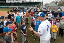 Mike Kazlausky, Air Force Academy baseball head coach, talks to the more than 30 boys and girls participating in the kids' baseball clinic taught by coaches and players from the Air Force and Naval Academy baseball teams Feb. 24, 2018, at Grainger Stadium in Kinston, North Carolina. The coaches and players taught the kids a variety of baseball skills to include, how to throw a baseball, how to field ground balls and line drives, and how to run the bases. (U.S. Air Force photo by Tech. Sgt. David W. Carbajal)