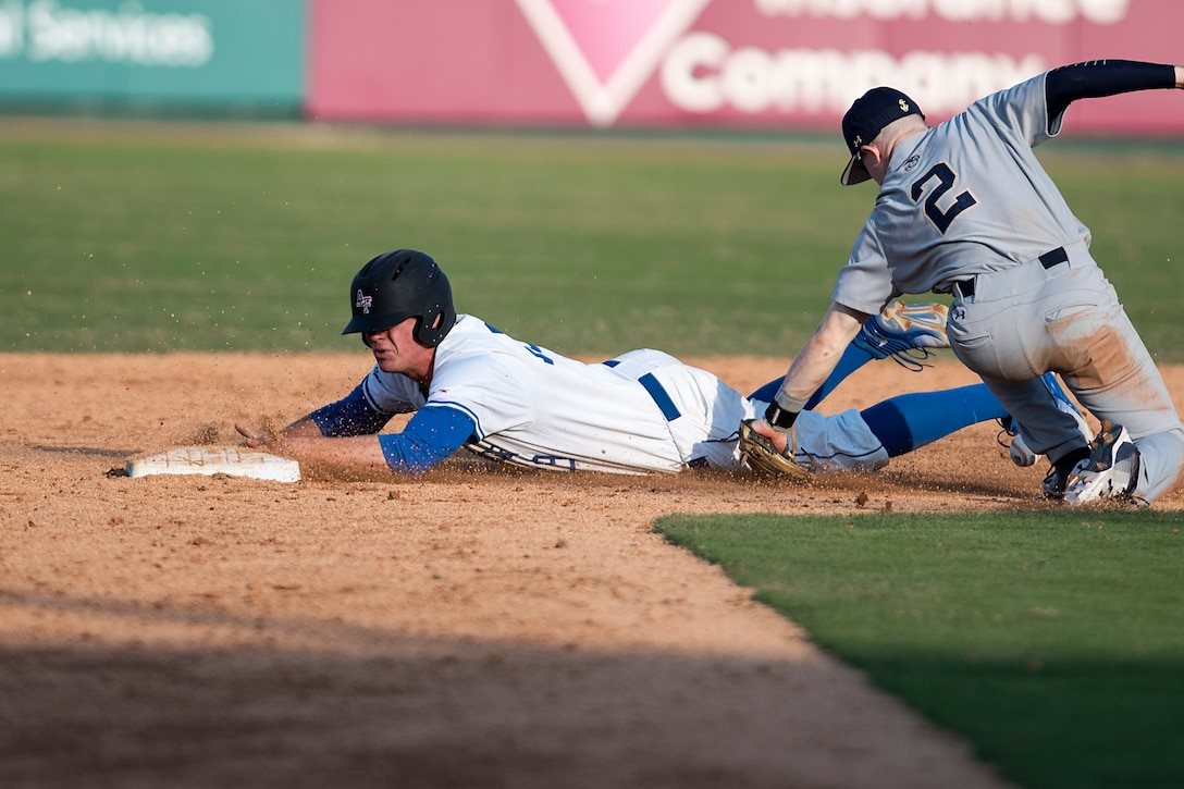 Air Force Academy outfielder Drew Wiss slides into second base Feb. 24, 2018, during the Freedom Classic baseball tournament at Grainger Stadium in Kinston, North Carolina. Wiss is a third-year cadet at the Air Force Academy originally from Elgin, Illinois. Navy took games one and two of the three game series against the Air Force Academy. (U.S. Air Force photo by Tech. Sgt. David W. Carbajal)