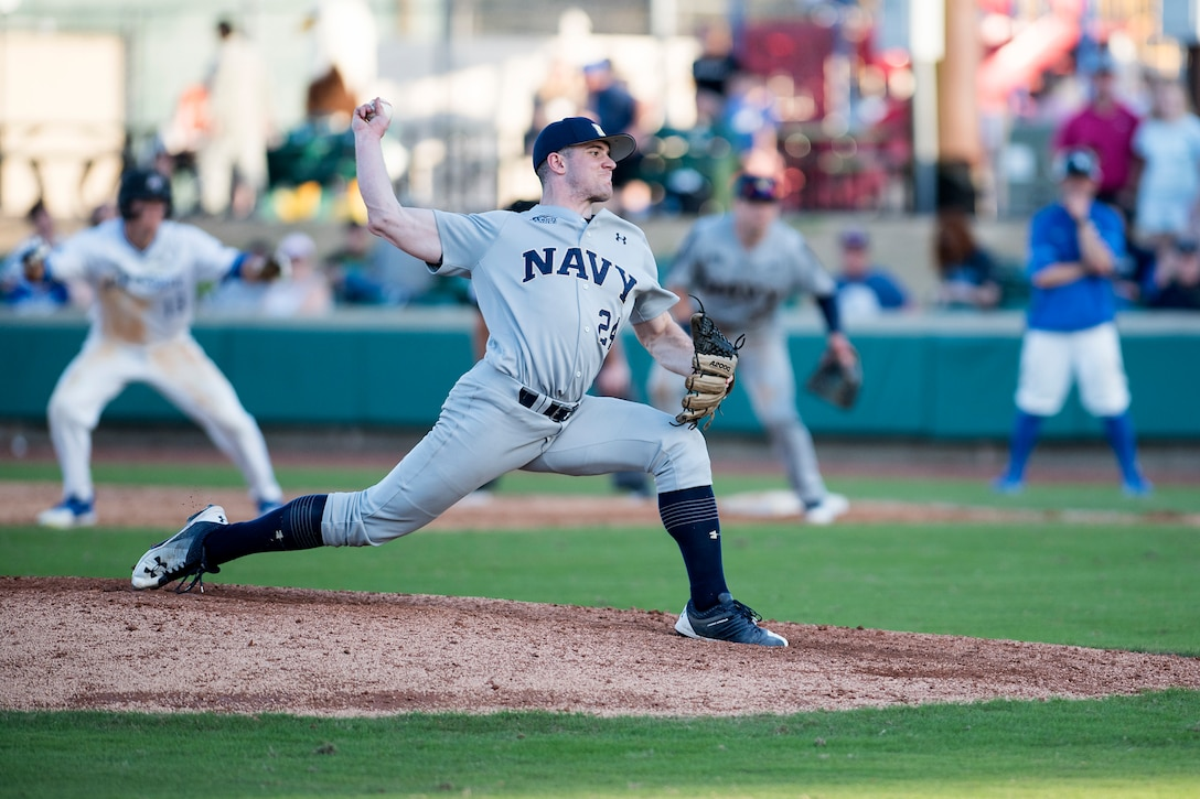 Naval Academy closer Tommy Goodridge throws to home plate Feb. 24, 2018, during the Freedom Classic baseball tournament at Grainger Stadium in Kinston, North Carolina. Goodridge is a first-year cadet at the Naval Academy originally from San Diego. Navy took games one and two of the three game series against the Air Force Academy. (U.S. Air Force photo by Tech. Sgt. David W. Carbajal)