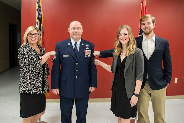 James W. Rivers, 123rd Intelligence Squadron Superintendent, and family pose during Rivers' Chief Master Sgt. Promotion at Ebbing Air National Guard Base, Fort Smith, Ark., Feb. 24, 2018.  Rivers enlisted in the Air Force in July, 1986, and has served vital roles in the intelligence community in both Active Duty and the Air National Guard. (U.S. Air National Guard photo by Senior Airman Matthew Matlock)