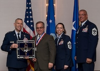 "Joseph M. DiMisa, Instructor of Environmental Management at the Air Force Institute of Technology at Wright-Patterson Air Force Base, Ohio, receives the 2017 Non-supervisory Civilian of the Year Award from Lt. Gen. Steve Kwast, Commander of AETC, during the AETC 12 Outstanding Airmen of the Year Awards banquet Feb. 22, 2018 in Orlando, Fla. DiMisa directed eight AFIT Civil Engineering courses, while teaching 130 instructional hours in 25 courses, educating 783 Department of Defense engineers, developed seven Air Force level on-demand environmental management mini-courses, which are used 8,000 times per month and saved the Air Force $400,000 annually, as well as authored and published ""Ecological Restoration of the Midwest"" a 296 page book and a first of its kind for the Midwest. (U.S. Air Force photo by Staff Sgt. Kenneth W. Norman)"