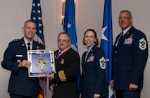 Paul Gentile, Assistant Chief for Fire Protection assigned to the 47th Civil Engineer Squadron at Laughlin Air Force Base, Texas, receives the 2017 Supervisory Civilian of the Year Award from Lt. Gen. Steve Kwast, Commander of Air Education and Training Command, during the AETC 12 Outstanding Airmen of the Year Awards banquet, Feb. 22, 2018 in Orlando, Fla. Gentile led the Wing fire prevention program, inspecting 61 facilities, identifying and correcting 46 safety violations and safe guarding 5,700 base personnel, provided vital Emergency Operations Command node during T-38 crash response, integrating with 11 agencies and hastened incident resolution, and oversaw the first-ever Junior Firefighter car show, leading 120 hours preparation and raising $2,500 enabling zero cost for the event. (U.S. Air Force photo by Staff Sgt. Kenneth W. Norman)