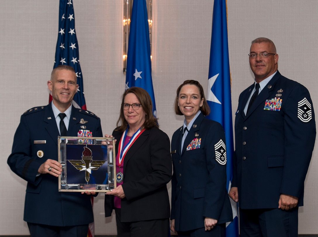 Brenda S. Sizemore, Director of Business Operations for the 17th Contracting Squadron at Goodfellow Air Force Base, Texas, receives the 2017 Supervisory Civilian of the Year Award from Lt. Gen. Steve Kwast, Commander of AETC, during the AETC 12 Outstanding Airmen of the Year Awards banquet Feb. 22, 2018 in Orlando, Fla. Sizemore earned Best AETC Contracting Civilian two years in a row, led AETC's best base-level cost reduction program, saving the Air Force $13 million over six years, as well as managed the Contracting Officer Warrant Program, helping to alleviate squadron buy shortfall while also increasing contract award production by 27 percent. (U.S. Air Force photo by Staff Sgt. Kenneth W. Norman)