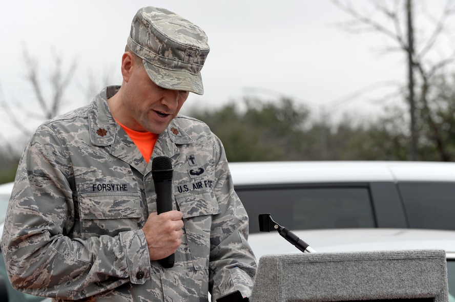 Chaplain (Maj.) Craig Forsythe, 67th Cyberspace Wing, provides the invocation during a ribbon-cutting ceremony in San Antonio, Texas, Feb. 23, 2018. The ceremony was held to mark the opening of a new 67th CW offensive cyberspace operations training location for cyberspace operators. (U.S. Air Force photo by Tech. Sgt. R.J. Biermann)