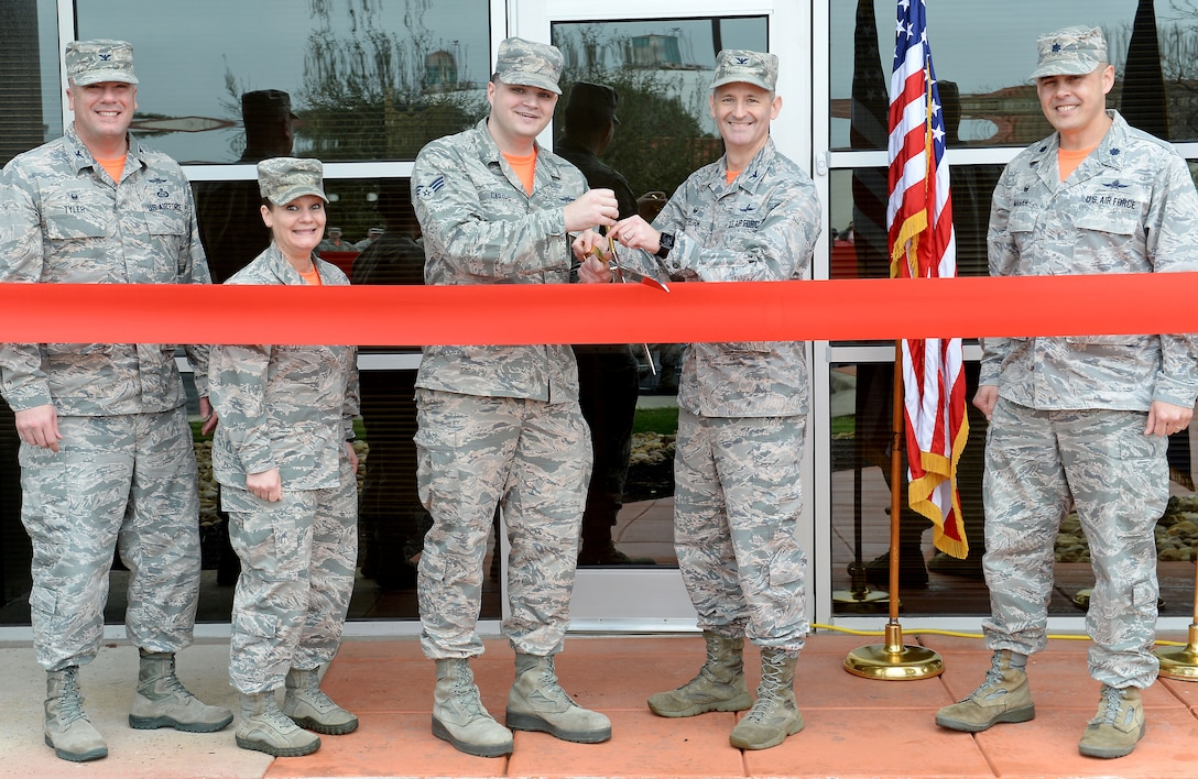 67th Cyberspace Wing leaders cut the ribbon to mark the opening of a new offensive cyberspace operations training location in San Antonio, Texas, Feb. 23, 2018. Cyberspace operators will receive centralized and standardized training at the new location, which aims to host its first class in March 2018. (U.S. Air Force photo by Tech. Sgt. R.J. Biermann)