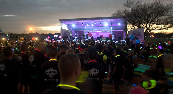 It's a Glow In The Park dance party at MacArthur Field at Joint Base San Antonio-Fort Sam Houston as participants enjoy the festivities after the 5K fun run Feb. 24.