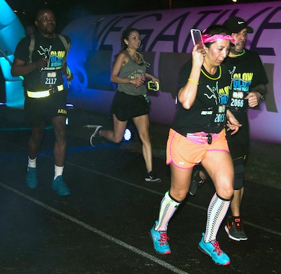 "The participants in the annual ""Glow In The Park"" 5K fun run at MacArthur Park at Joint Base San Antonio-Fort Sam Houston Feb. 24 were encouraged to wear glow-in-the-park paint and wild and colorful clothes."