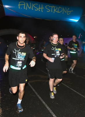 "Participants in the annual ""Glow In The Park"" 5K fun run at MacArthur Park at Joint Base San Antonio-Fort Sam Houston ""finish strong"" Feb. 24."