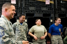 Chief Master Sgt. Ronald Killen, 23d Logistics Readiness Squadron (LRS) superintendent, shares a laugh with Airmen from the 23d LRS while they prepared for a Phase 1 exercise, Feb. 23, 2018, at Moody Air Force Base, Ga. The 23d LRS prepped approximately 400 A-bags, which consisted of items essential for deploying Airmen. This helped ensure the success of the Airmen participating in the exercise, which tested operations, maintenance and logistics to demonstrate the 23d Wing's ability to rapidly deploy to meet the needs of combatant commanders. (U.S. Air Force photo by Airman 1st Class Erick Requadt)