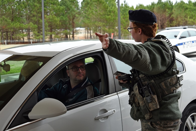 U.S. Air Force Airman 1st Class Andrea Pearson, 20th Security Forces Squadron entry controller, gives a base visitor directions at Shaw Air Force Base, S.C., Feb. 13, 2018.