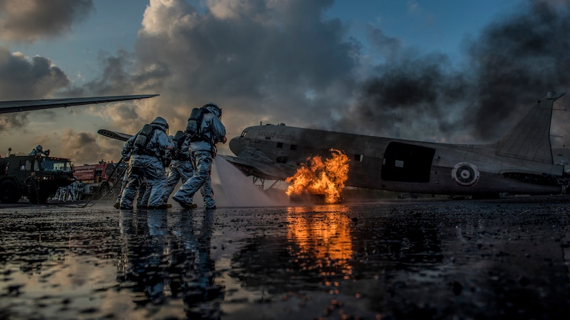 Marine Corps firefighters from Marine Wing Support Squadron 172 and Royal Thai Navy firefighters work together to extinguish an aircraft fire simulating a crash during aircraft extraction training at U-Tapao International Airport, Ban Chang district, Rayong province, Thailand.