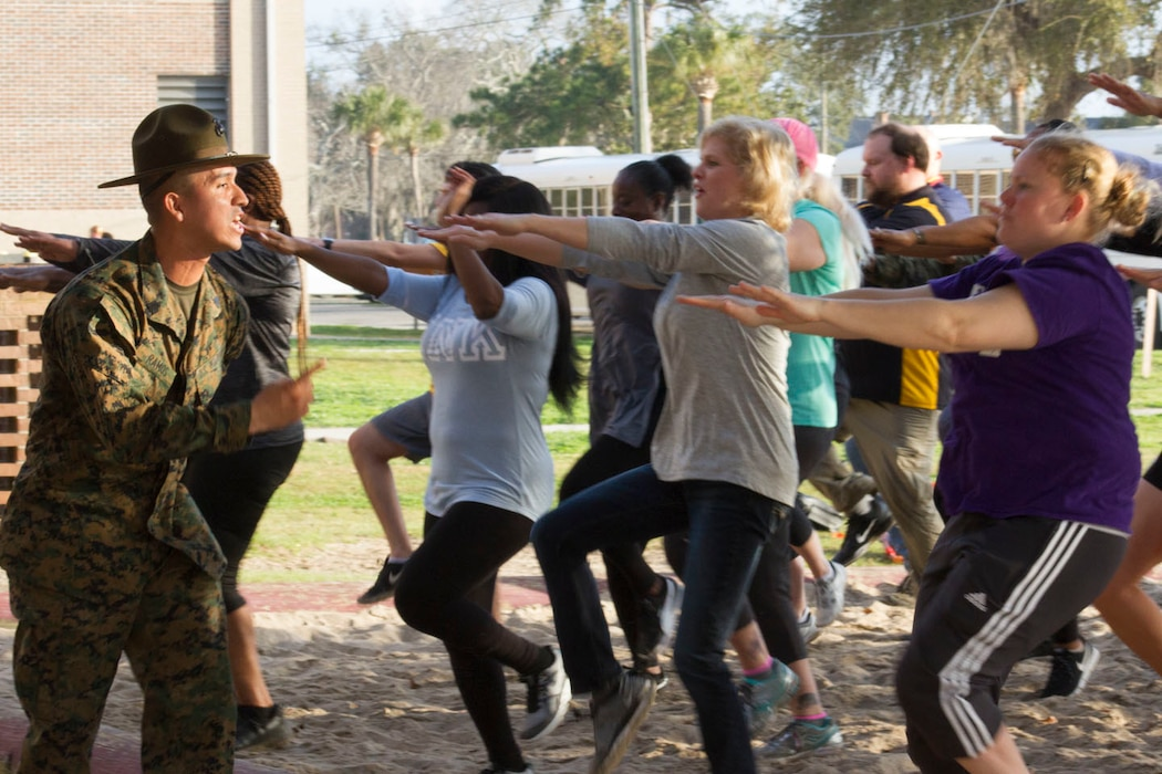 Sergeant Luis Ramos, a drill instructor with Recruit Training Regiment, encourages attendees through several exercises during the Educators Workshop aboard Marine Corps Recruit Depot Parris Island, South Carolina, Feb. 21, 2018. These educators traveled from Recruiting Station (RS) Atlanta and RS Jacksonville to experience the workshop. The workshop allows educators to have an inside look at educational benefits and career opportunities in the Marine Corps to better inform their students. (U.S. Marine Corps photo by Cpl. Jorge A. Rosales)