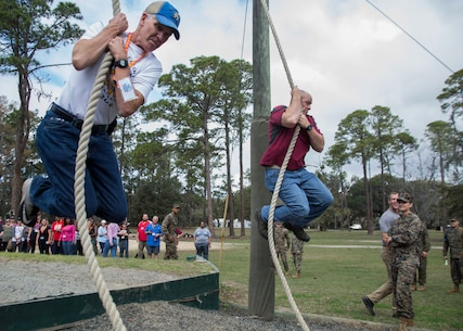 Attendees of the Educator's Workshop participate in the Confidence Course aboard Marine Corps Recruit Depot Parris Island, South Carolina, Feb. 22, 2018. These educators traveled from Recruiting Station (RS) Atlanta and RS Jacksonville to experience the workshop. The workshop allows educators to have an inside look at educational benefits and career opportunities in the Marine Corps to better inform their students. (U.S. Marine Corps photo by Lance Cpl. Jack A. E. Rigsby)