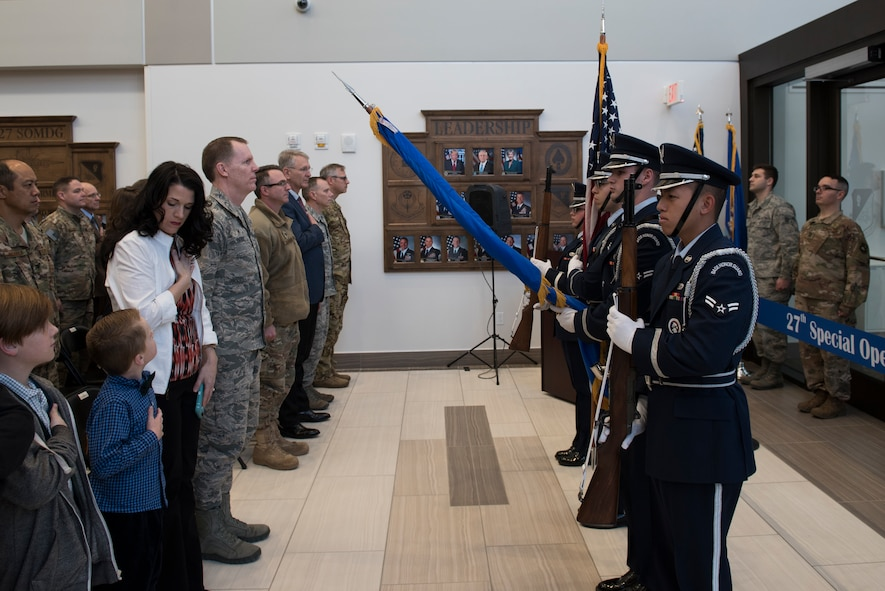 Cannon Air Force Base Honor Guard members present the colors during the 27th Special Operations Medical Group building ribbon cutting ceremony at Cannon AFB, N.M., Feb. 23, 2018. The layout of the new building was designed with patients in mind. Physical therapy and the pharmacy, both high-traffic areas, are located near the main entrance. (U.S. Air Force photo by Staff Sgt. Michael Washburn/Released)