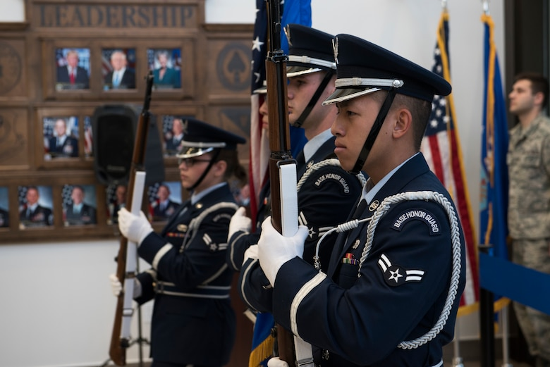 Cannon Air Force Base Honor Guard members present the colors during the 27th Special Operations Medical Group building ribbon cutting ceremony at Cannon AFB, N.M., Feb. 23, 2018. The layout of the new building aims to be more accommodating to customers as the first floor is primarily for family members. (U.S. Air Force photo by Staff Sgt. Michael Washburn/Released)
