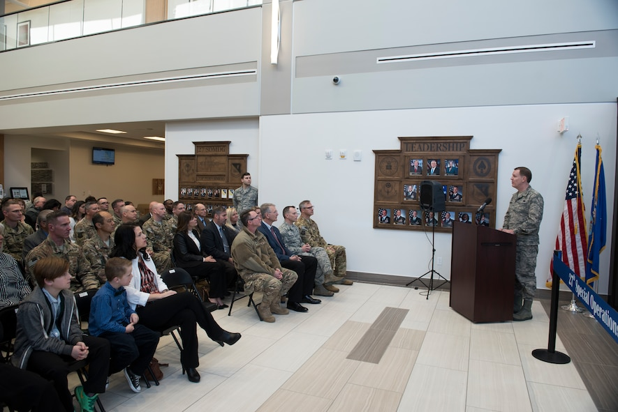 Col. Christopher Patrick, 27th Special Operations Medical Group commander, delivers remarks during the 27th SOMDG building ribbon cutting ceremony at Cannon AFB, N.M., Feb. 23, 2018. The layout of the new building was designed with patients in mind. Physical therapy and the pharmacy, both high-traffic areas, are located near the main entrance. (U.S. Air Force photo by Staff Sgt. Michael Washburn/Released)
