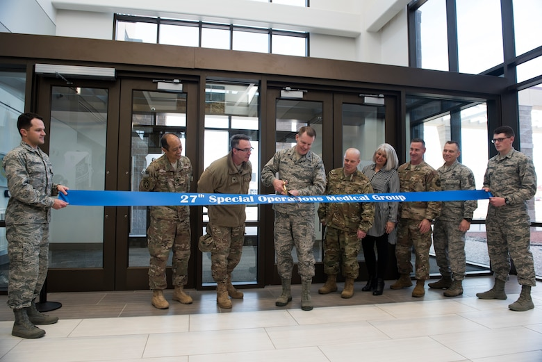 Col. Christopher Patrick, 27th Special Operations Medical Group commander, cuts the formal ribbon during the 27th SOMDG building ribbon cutting ceremony at Cannon AFB, N.M., Feb. 23, 2018. The upgrade to the new medical group facility is just one more way that Cannon is committed to being a premier installation. (U.S. Air Force photo by Staff Sgt. Michael Washburn/Released)