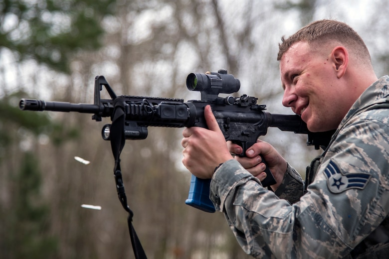 Senior Airman Adam Irwin, 23d Security Forces Squadron installation patrolman, fires an M4 carbine after a training event, Feb. 22, 2018, at Moody Air Force Base, Ga.  The Shoot, move, communicate training event is designed to test participants on their ability to move from barricade to barricade as a team. To be successful, one member provided covering fire while others advanced on the enemy, then retreated from the scenario while they maintained cover fire. Security Forces members could employ these tactics anytime they're under enemy fire.
