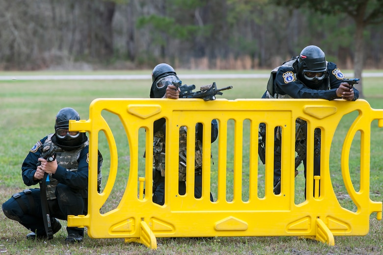 Personnel from the 23d Security Forces Squadron defend their positions during a shoot, move, communicate, training, Feb. 22, 2018, at Moody Air Force Base, Ga.  The Shoot, move, communicate training event is designed to test participants on their ability to move from barricade to barricade as a team. To be successful, one member provided covering fire while others advanced on the enemy, then retreated from the scenario while they maintained cover fire. Security Forces members could employ these tactics anytime they're under enemy fire.