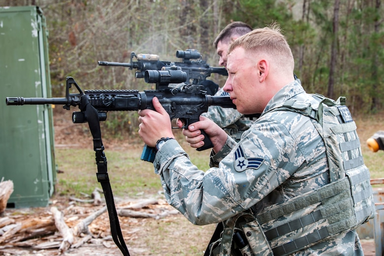 Senior Airman Adam Irwin, front, 23d Security Forces Squadron installation patrolman, and Tech Sgt. Stephen O'Hara, 23d Security Forces Squadron flight chief, fire M4 carbines after a training event, Feb. 22, 2018, at Moody Air Force Base, Ga.  The Shoot, move, communicate training event is designed to test participants on their ability to move from barricade to barricade as a team. To be successful, one member provided covering fire while others advanced on the enemy, then retreated from the scenario while they maintained cover fire. Security Forces members could employ these tactics anytime they're under enemy fire.