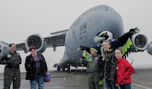 McKay Neel (third from left), McChord's newest Pilot for a Day participant, and two friends take a photo with Blitz, Seattle Seahawks mascot, during a tour of McChord Field at Joint Base Lewis-McChord, Wash., Feb. 20, 2018. McKay was joined on his tour by his parents, two friends, their dad and 4th Airlift Squadron personnel. (U.S. Air Force photo by Senior Airman Tryphena Mayhugh)