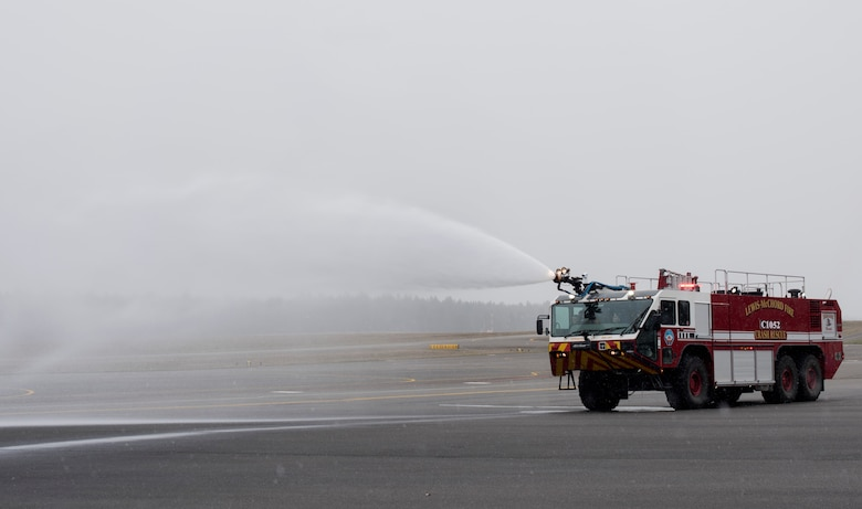 McKay Neel, McChord's newest Pilot for a Day participant, sprays water out of a fire truck during a McChord Field tour at Joint Base Lewis-McChord, Wash., Feb. 20, 2018. McKay also saw a demonstration by military working dogs, learned about survival, evasion, resistance and escape at SERE training, flew a C-17 Globemaster III simulation and toured an actual C-17 during his visit. (U.S. Air Force photo by Senior Airman Tryphena Mayhugh)