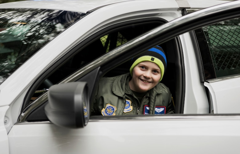 McKay Neel, McChord's newest Pilot for a Day participant, sits in a new 62nd Security Forces Squadron patrol vehicle during a tour of McChord Field at Joint Base Lewis-McChord, Wash., Feb. 20, 2018. The Pilot for a Day program aims to give each child a break from whatever challenges they may face by giving them their own special day. (U.S. Air Force photo by Senior Airman Tryphena Mayhugh)