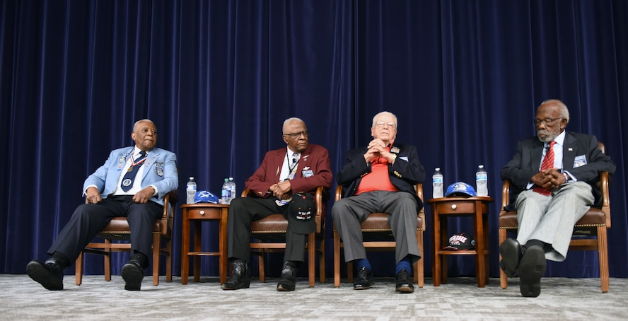Tuskegee Airmen, Lt. Col. Eugene Richardson, Lt. Col. James Harvey, Lt. Col. George Hardy and Lt. Col. Theodore Lumpkin, speak to Air Command and Staff College students at the Wood Auditorium on Maxwell Air Force Base, Alabama, Feb. 26, 2018. The four men each spoke about their time as Tuskegee Airmen and the hardships they had to endure during World War II, when segregation existed within the U.S. armed forces. (U.S. Air Force photo by Senior Airman Tammie Ramsouer)
