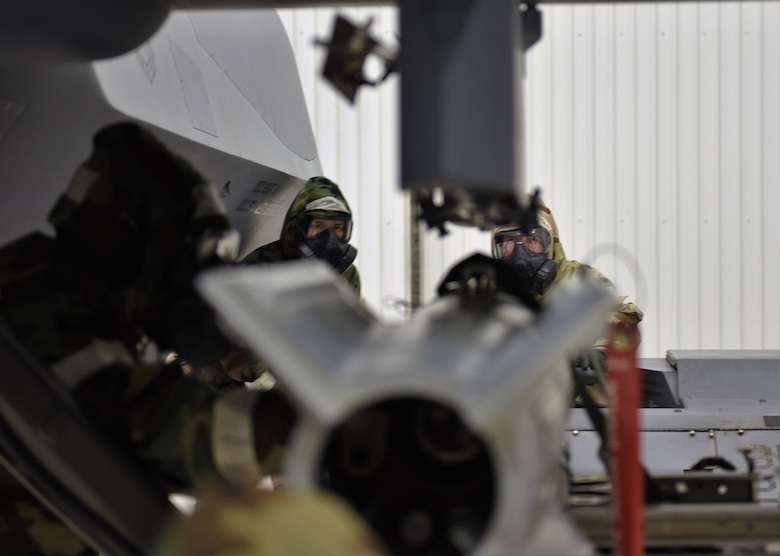Airmen from the 49th Maintenance Group load weapons onto a MQ-9 Reaper during a phase II exercise at Holloman Air Force Base, N.M., Feb. 22, 2018. This exercise is a first among remotely piloted aircraft bases and the 49th MXG reached out Osan Air Base for support. (U.S. Air Force photo by Staff Sgt. Timothy Young)