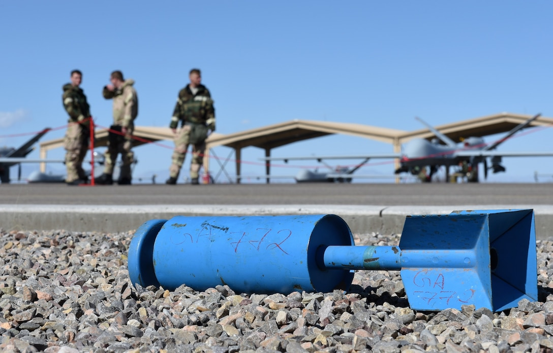 A post attack reconnaissance team cordons off a simulated unexploded ordnance during a 49th Maintenance Group phase II exercise at Holloman Air Force Base, N.M., Feb. 22, 2018. The simulated exercise objective was to train and prepare Holloman Airmen for threats including chemical, biological, radiological and nuclear attacks. (U.S. Air Force photo by Staff Sgt. Timothy Young)