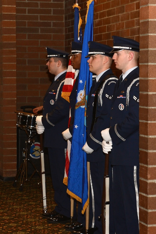 Members of the McChord Field Honor Guard prepare to present the U.S. and Air Force flags during the 2017 Annual Awards Banquet at the McChord Field Club, Joint Base Lewis-McChord, Wash., Feb. 23, 2018. The McChord Field Honor Guard participates in many official ceremonies as well as render military honors to Air Force personnel and their families during funeral services.