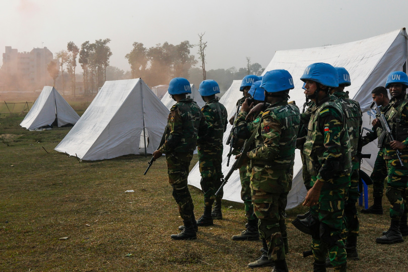 Bangladesh Army soldiers of the Engineer Corps prepare to counter attack role-players during a rehearsal for a demonstration as part of Exercise Shanti Doot 4 in Bangladesh.