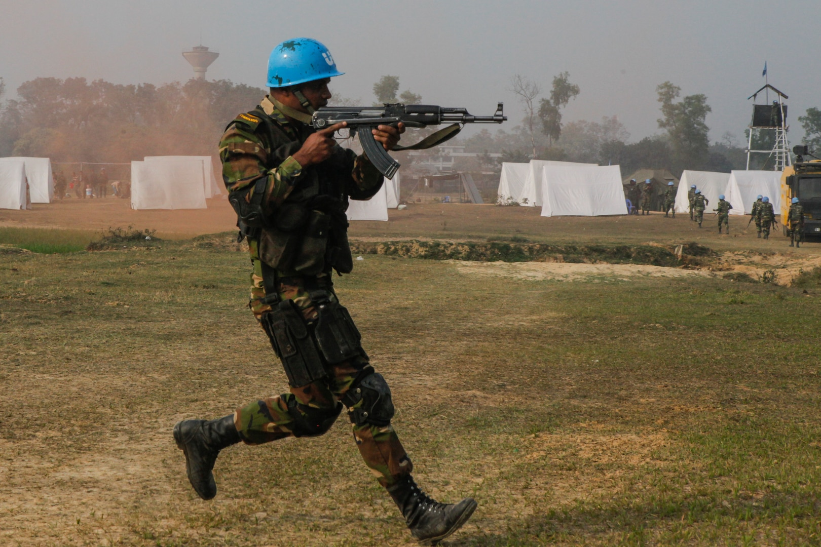 A Bangladesh Army soldier of the Para-Commando Brigade runs to secure a drop zone during a rehearsal for a demonstration as part of Exercise Shanti Doot 4 in Bangladesh.