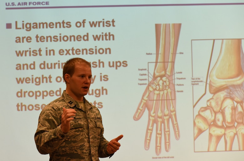 Individual gives a briefing on physical therapy techniques