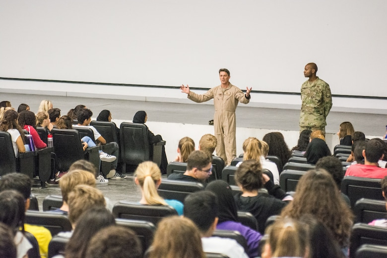 Eighth grade students learn about the mission of Al Udeid Air Base