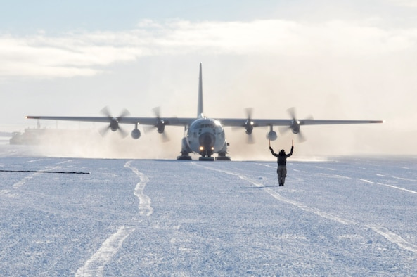 "Staff Sgt. Latisha Webb, 139th Expeditionary Airlift Squadron crew chief, taxis an LC-130 ""Skibird"" into the fuel pit on the Williams Field skiway at McMurdo Station, Antarctica, on Nov. 6, 2017."