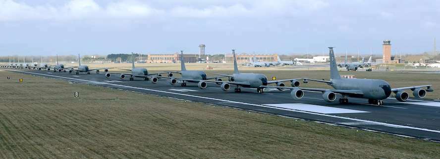 Twelve U.S. Air Force KC-135 Stratotankers assigned to the 100th Air Refueling Wing taxi down the runway at RAF Mildenhall, England, Feb. 27, 2018. The show of force maneuver demonstrates the readiness of the wing to provide global air refueling support at short notice. (U.S. Air Force photo by Senior Airman Justine Rho)
