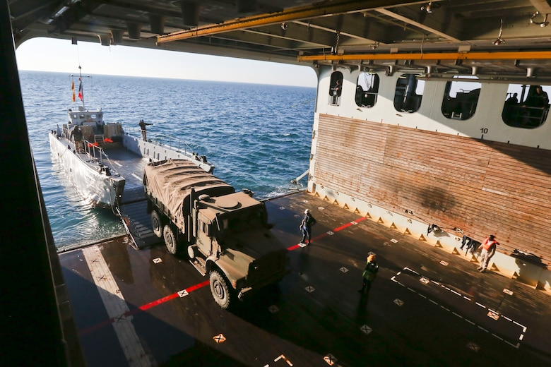A French landing craft unit transports U.S. Marine Corps medium tactical vehicle replacement trucks during an amphibious offload with French forces aboard French amphibious assault ship LHD Tonnerre (L9014). Tonnerre, with embarked Marines and Sailors from the 15th Marine Expeditionary Unit and Naval Amphibious Force, Task Force 51, 5th Marine Expeditionary Brigade, is conducting maritime security operations within the U.S. 5th Fleet area of operations to ensure regional stability, freedom of navigation and the free flow of commerce.