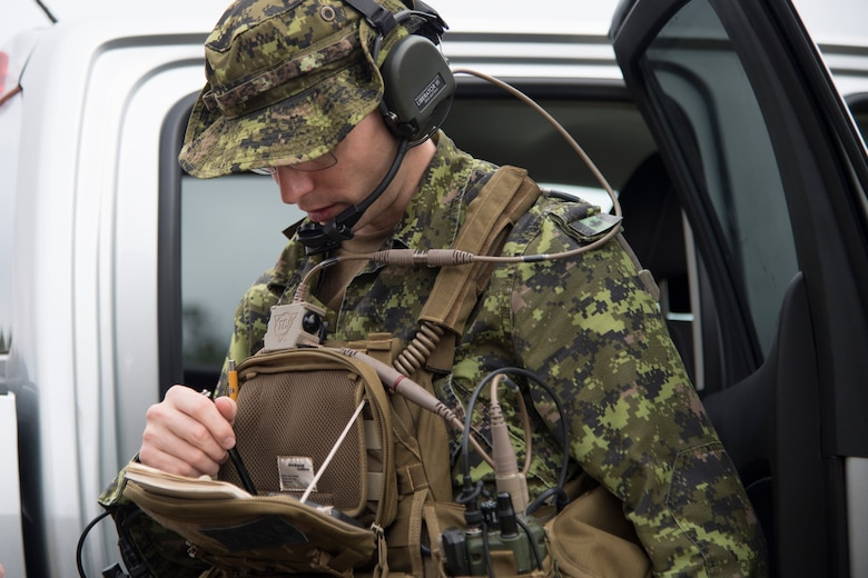 Canadian Royal Air Force Warrant Officer Macintyre, joint terminal attack controller, uses a device to confirm coordinates during combined training, Feb. 20, 2018, in Lakeland, Ga. Ally forces from the CRAF and New Zealand army traveled to Moody Air Force Base to train with the 75th Fighter Squadron on close air support. (U.S. Air Force photo by Staff Sgt. Eric Summers Jr.)