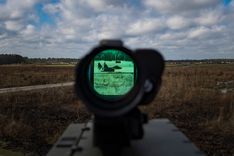 A laser target designator is calibrated to a simulated enemy target location during combined training, Feb. 21, 2018, at Moody Air Force Base, Ga. Ally forces from the Canadian Royal Air Force and New Zealand army traveled to Moody AFB to train with the 75th Fighter Squadron on close air support. (U.S. Air Force photo by Staff Sgt. Eric Summers Jr.)