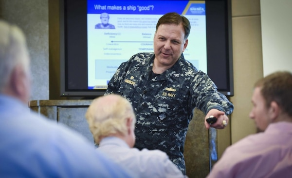 Capt. Mark Vandroff answers a question during the first presentation of the Rear Adm. David W. Taylor Naval Architecture Lecture Series, held Feb. 15, 2018, at the West Bethesda, Md., headquarters of Naval Surface Warfare Center, Carderock Division.