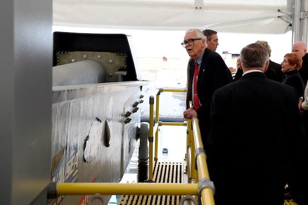 IMAGE: DAHLGREN, Va. (Feb. 22, 2018) – Dr. Hans Mark, former Secretary of the Air Force, looks over the electromagnetic railgun located at Naval Surface Warfare Center Dahlgren Division. Mark and retired Adm. James Hogg were honored during an electromagnetic railgun line naming ceremony. As public servants, Hogg and Mark laid the foundation for the U.S. Navy Railgun Program and led the effort to explore and illustrate to senior leadership the warfighting advantages of this game-changing technology and were pivotal in gaining the initial funding necessary to demonstrate its feasibility. (U.S. Navy photo by John F. Williams/Released)