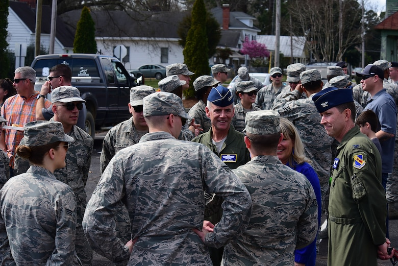 Lt. Gen. Jay Silveria, superintendent of the U.S. Air Force Academy, Colo., center, and Col. Christopher Sage, 4th Fighter Wing commander, right, talk with members of Team Seymour before game two of the 2018 Freedom Classic, Feb. 24, 2018, at Grainger Stadium in Kinston, North Carolina. The Falcons lost the series against the Midshipmen 2-1. (U.S. Air Force photo by Airman 1st Class Kenneth Boyton)