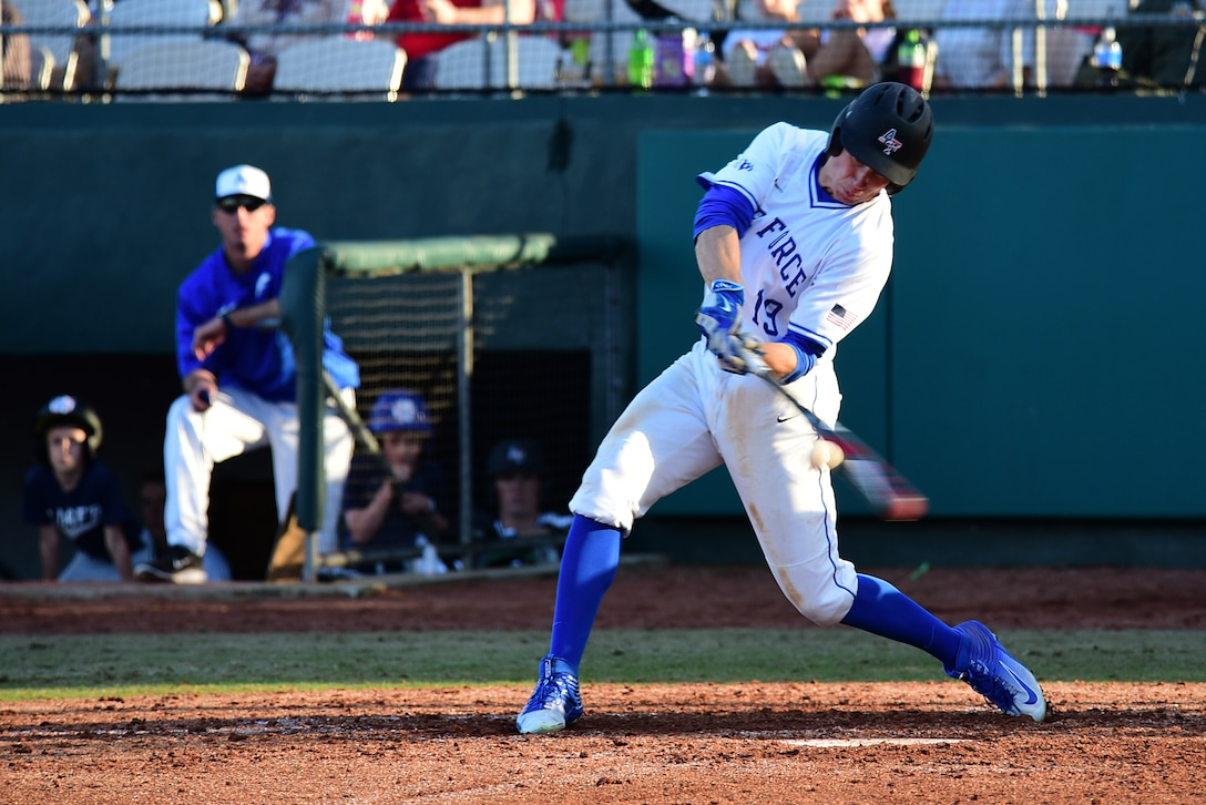 Air Force Academy center fielder Daniel Jones hits a baseball during game two of the 2018 Freedom Classic, Feb. 24, 2018, at Grainger Stadium in Kinston, North Carolina. The Falcons lost games one and two but were able to rally together in an 11-10 win over Navy in game three Feb. 25. (U.S. Air Force photo by Airman 1st Class Kenneth Boyton)