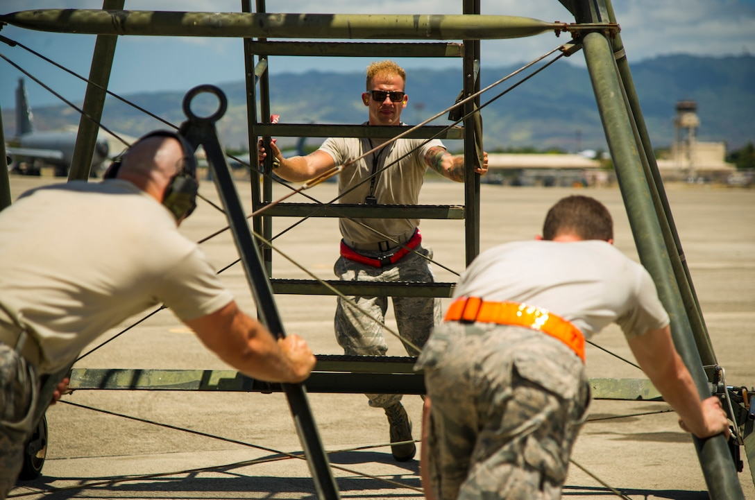 Maintainers move a stand for a C-5