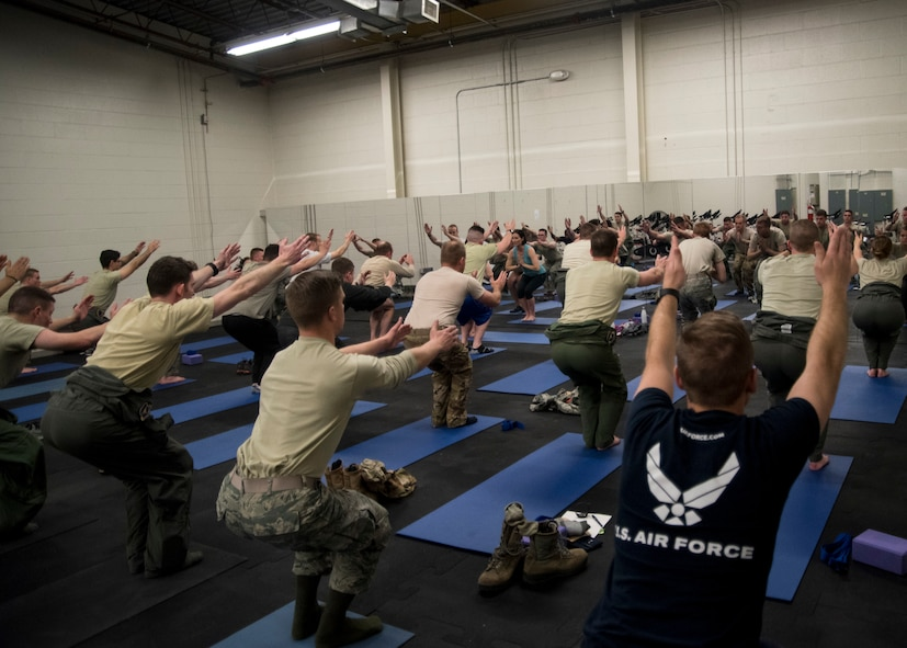 58th Special Operations Wing Airmen perform yoga at a performance skills workshop at Kirtland Air Force Base, N.M., Feb. 12. The workshop is a monthly battery of instruction being offered to students so they can be the best version of themselves.