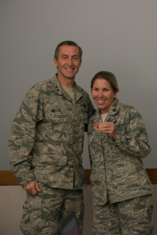 "Maj. Shari Lemoine, 482nd Fighter Wing Executive Officer, received a coin from Tenth Air Force Commander, Maj. Gen. Ronald B. ""Bruce"" Miller in recognition of her contribution to the conference."